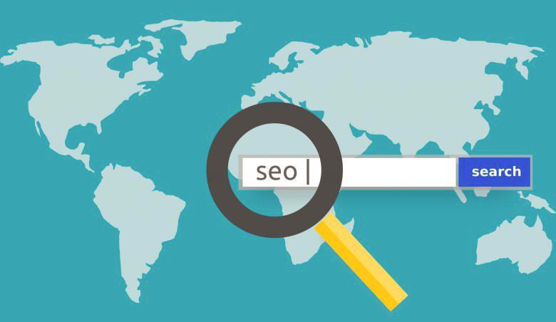 Una lente d'ingrandimento su un globo che rappresenta la ricerca effettuata tramite Google